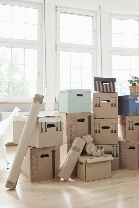 moving during Covid cardboard boxes in an empty apartment