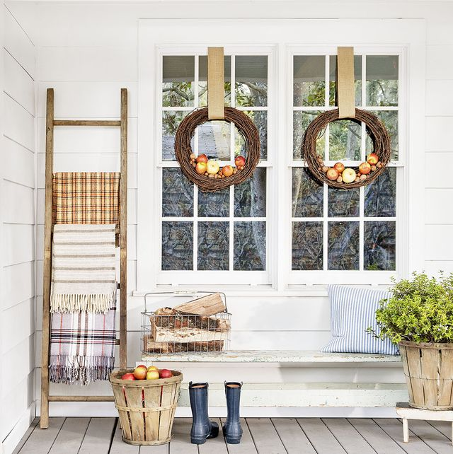 veranda with crowns, ladder and planter with basket of bushels