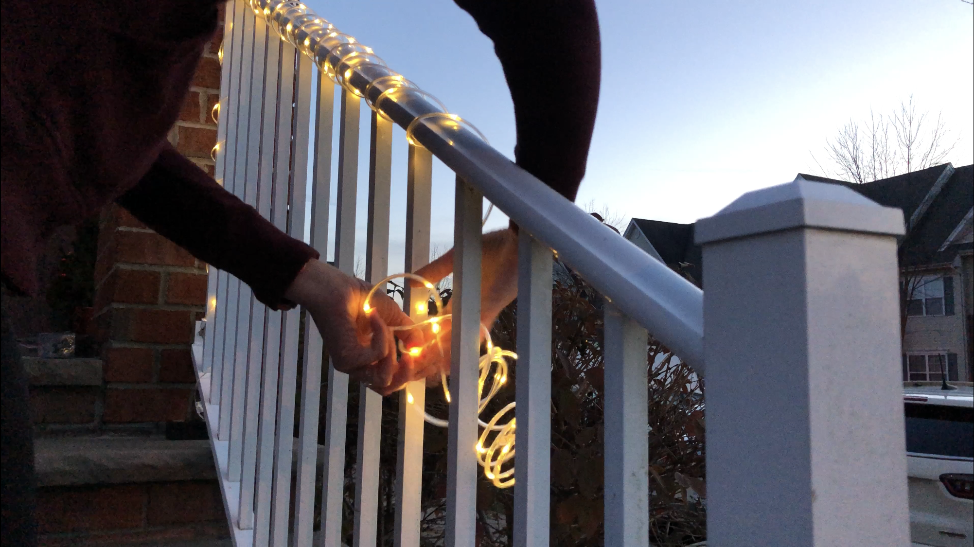 A strand of micro dot LEDs wrapped around a banister.