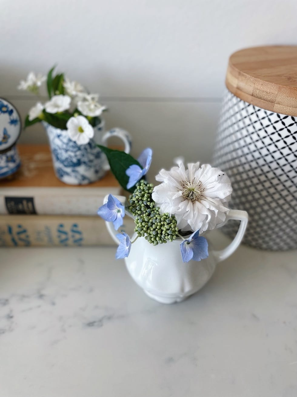 Small bouquets in reused small vases